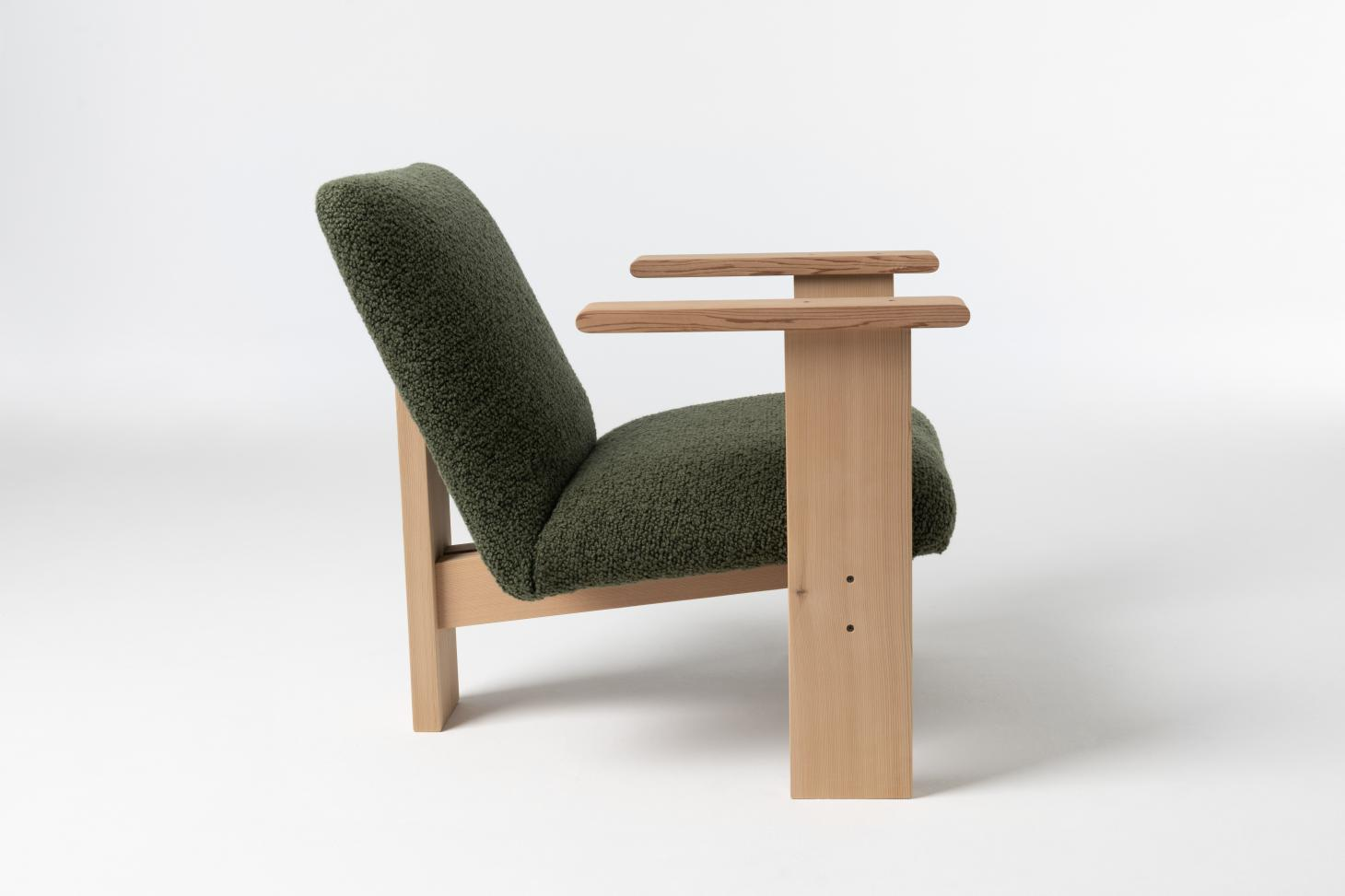 Armchair with wooden frame and green upholstered seat and back