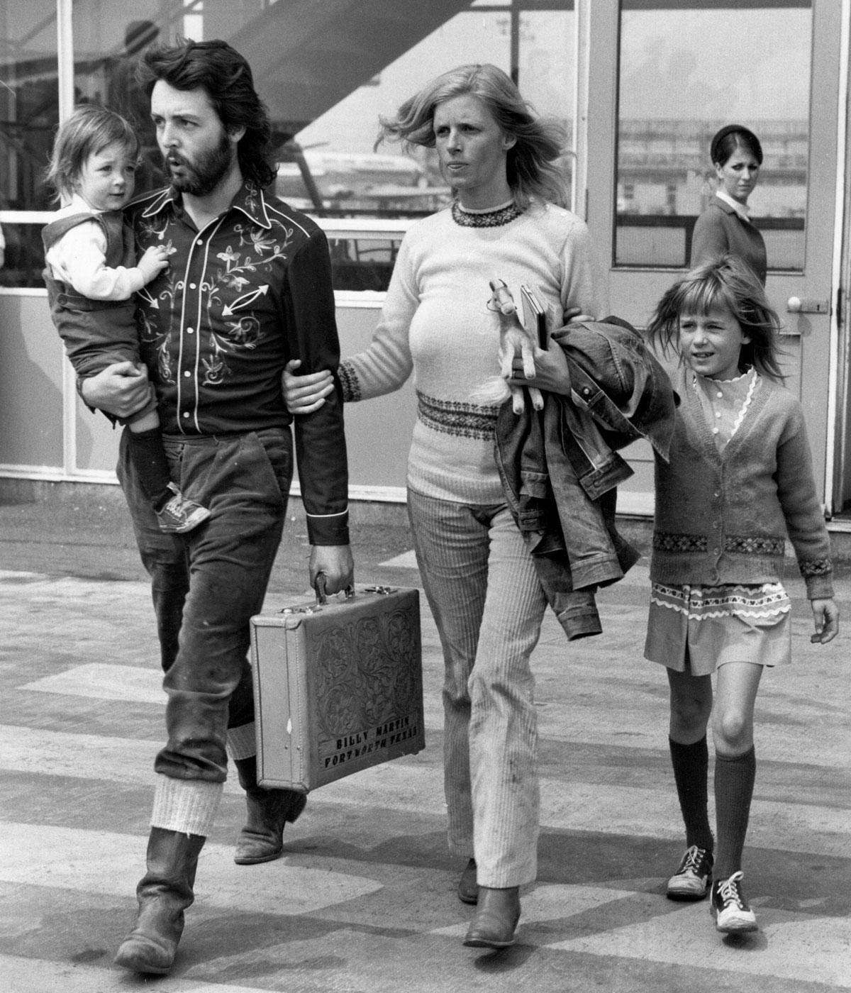 Black and white image of paul and linda mccartney with their two children