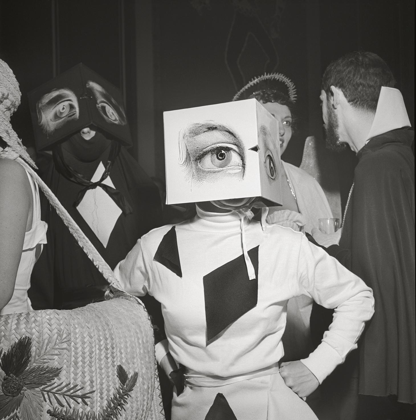 A partygoer wearing a Cubist headdress at Philadelphia's first beaux-arts ball, 1949, captured by Stanley Kubrick