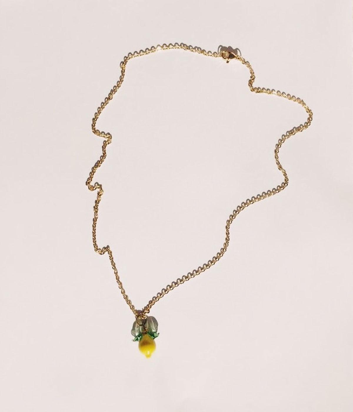 Gold chain with a yellow lemon pendant