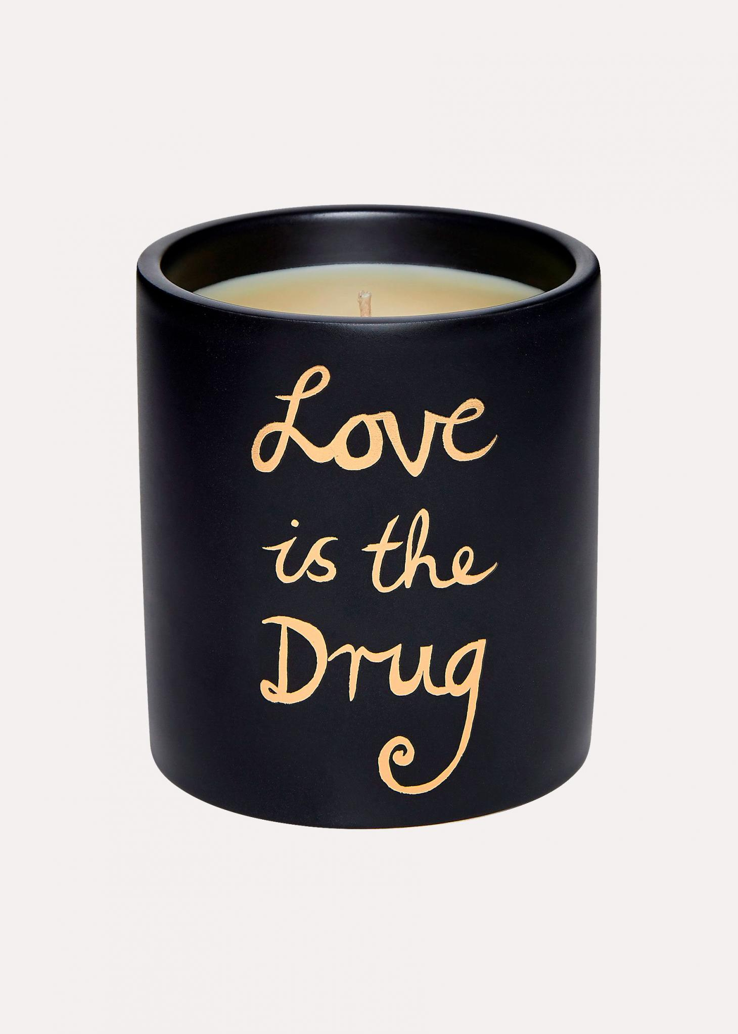 Bella Freud Love is the Drug candle against black background