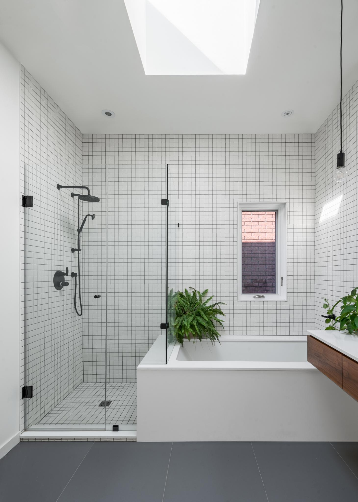 bathroom with grid tiles in Toronto townhouse