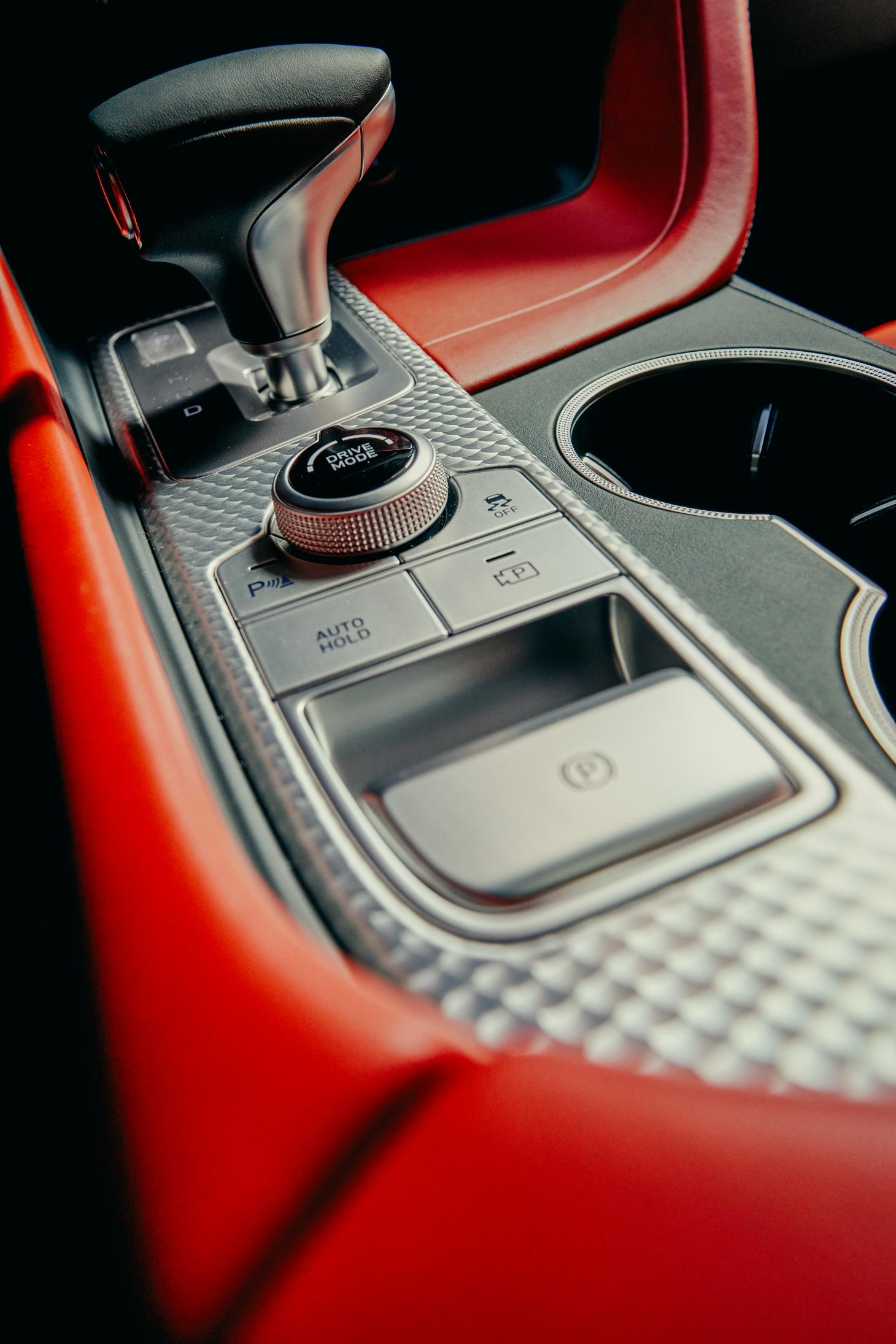 Genesis G70 car, interior detail image showing gear shift and controls