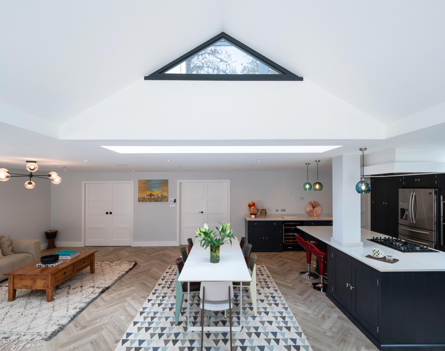 The Timber House's main living space and dramatic roof structure