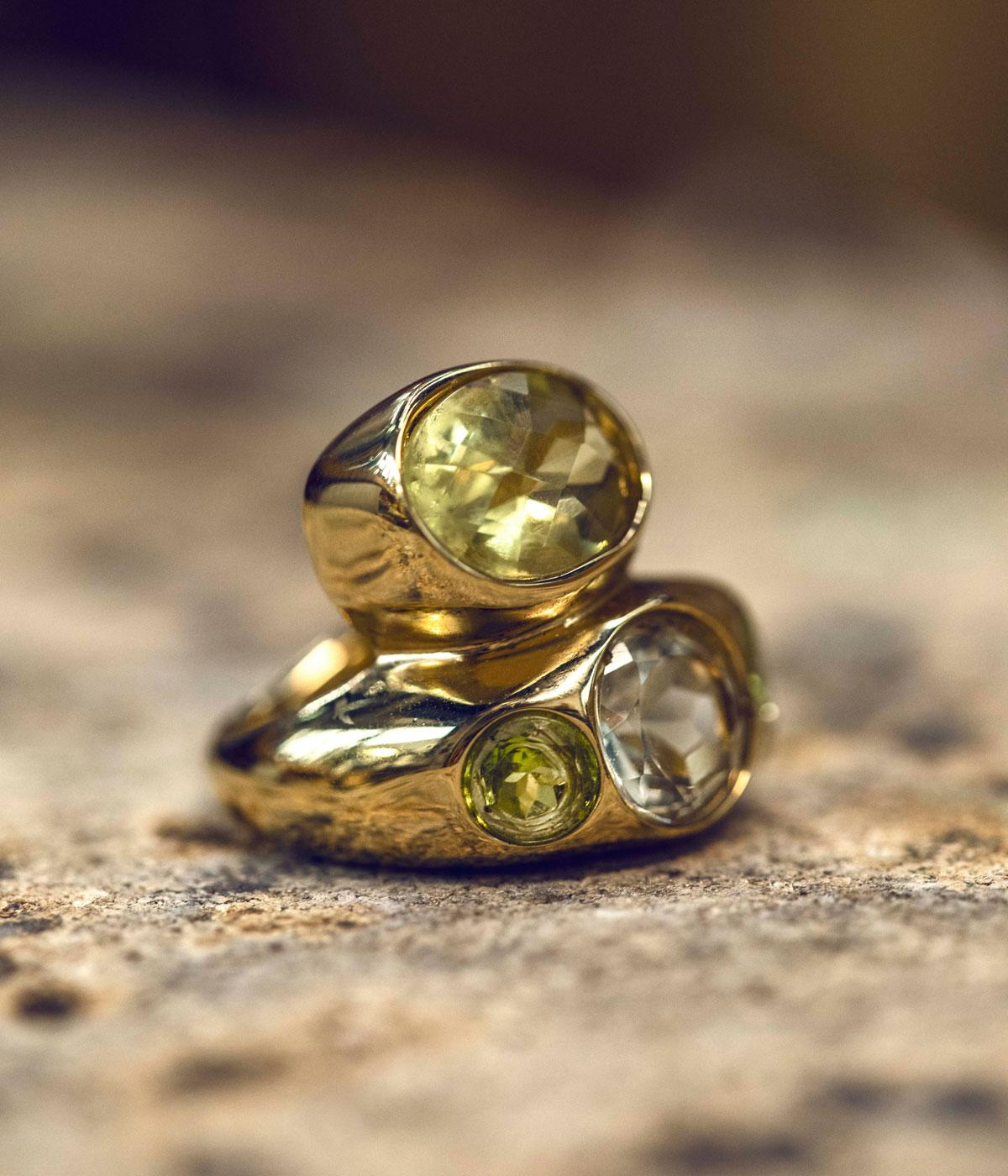 Gold rings with peridots stacked on top of each other