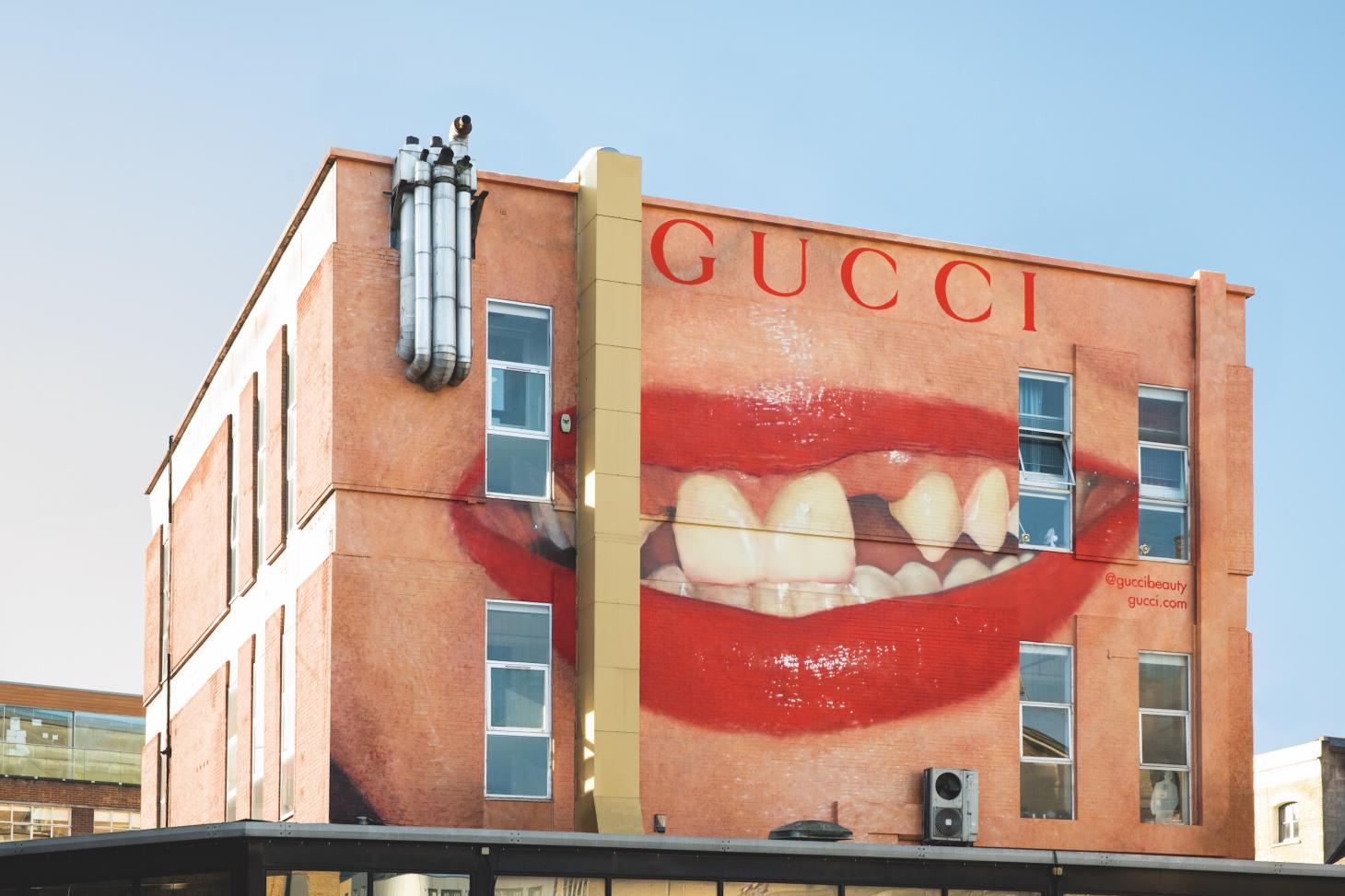 painting of red lips on a London wall