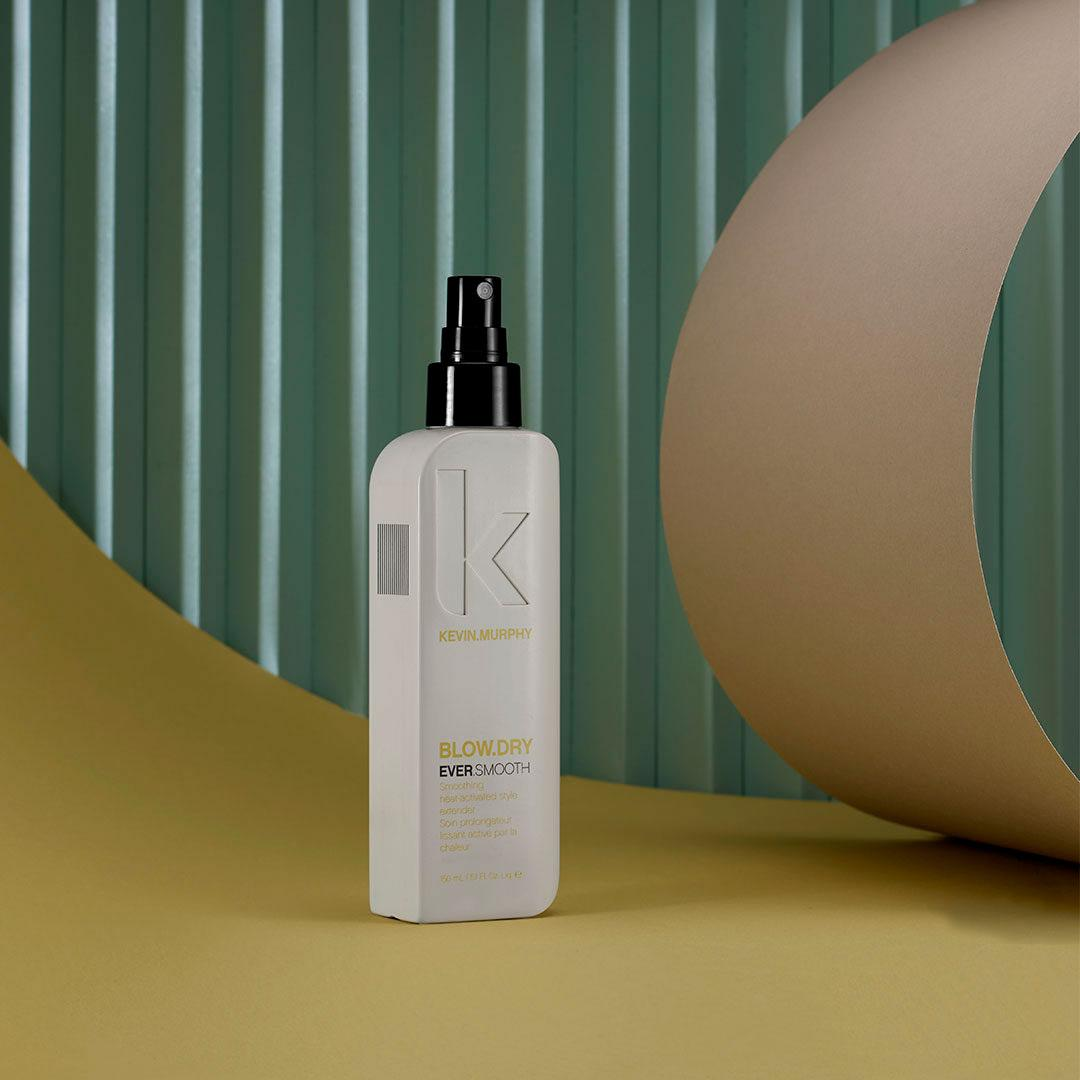 kevin murphy blow dry hair product in white container against green background