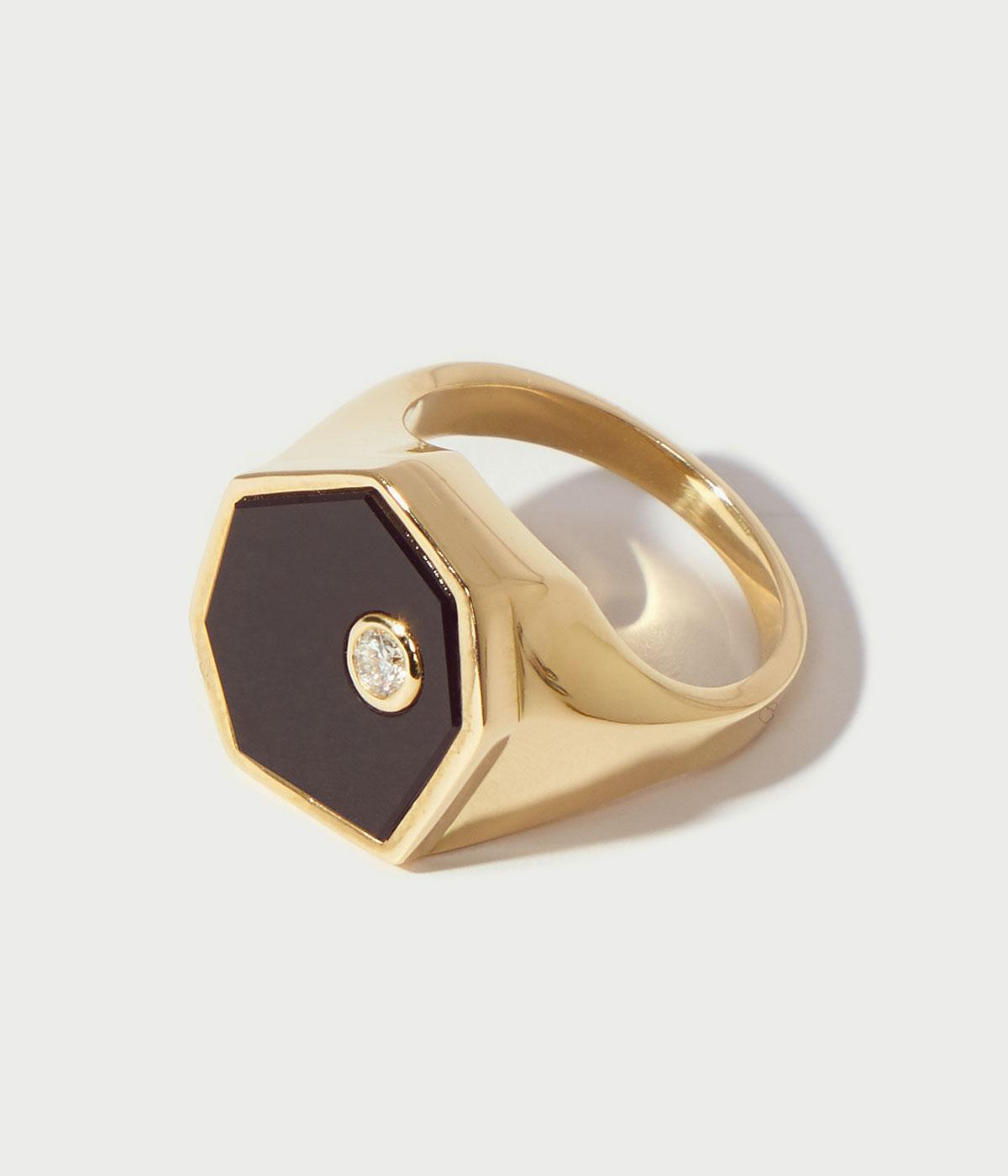 onyx and gold signet ring with a diamond