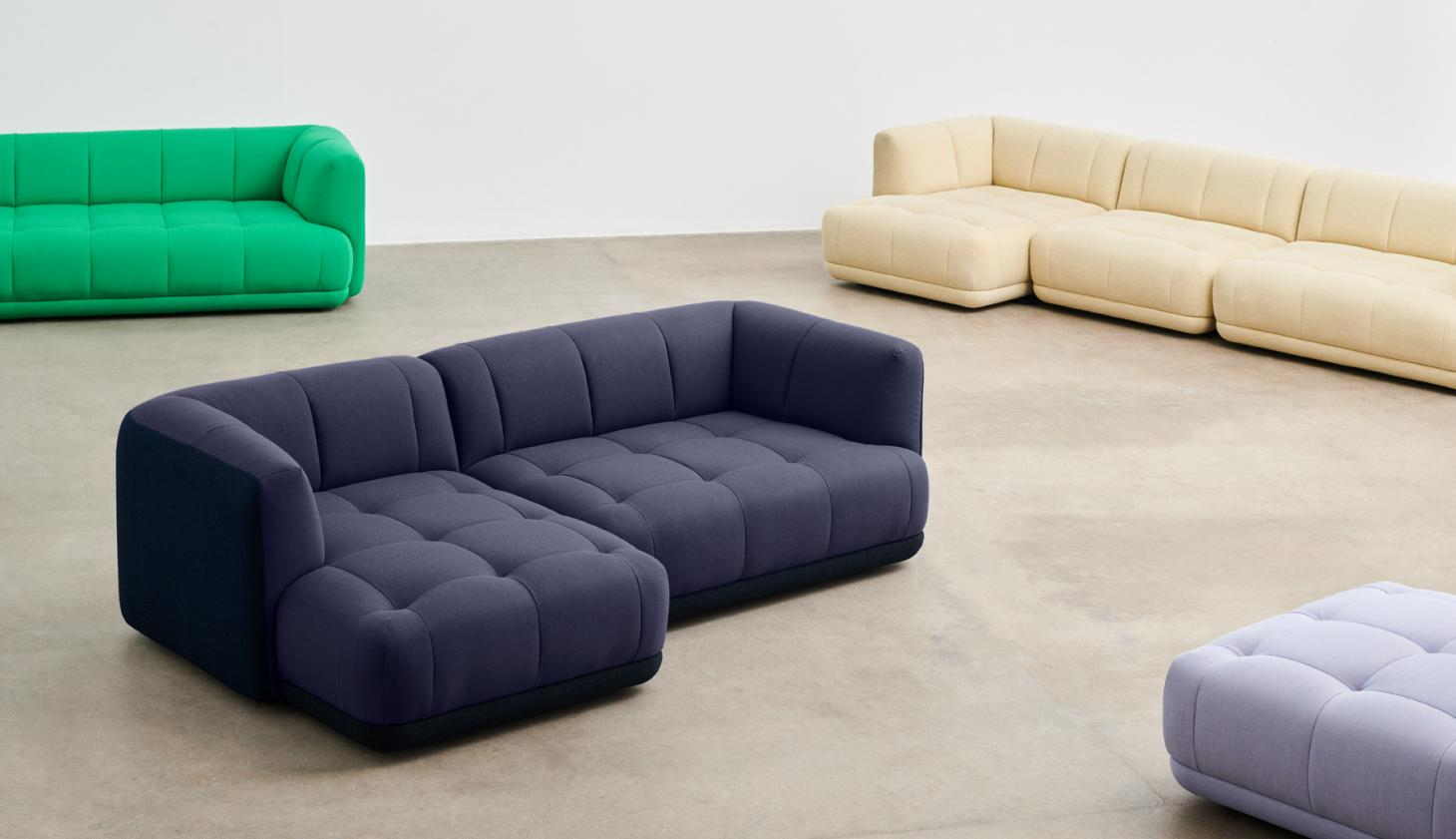 Shot in a studio space with concrete floor, the Quilton sofa is seen here in different configurations, in colours including cream, blue, grey and green