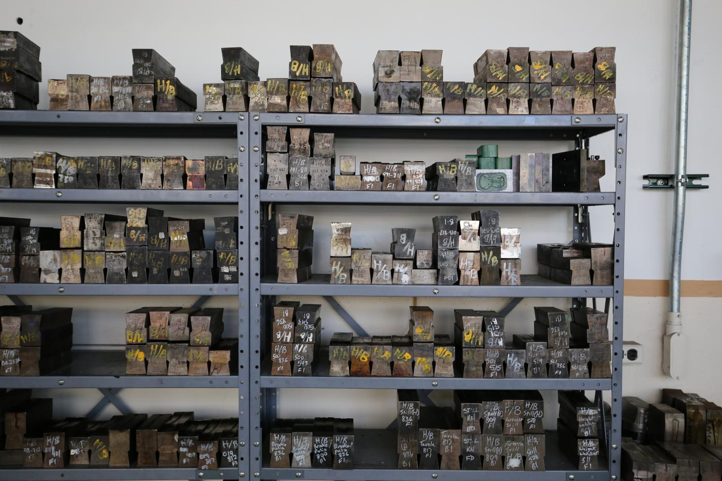 Shelves of tooling for different handles at the Sherrill factory in New York
