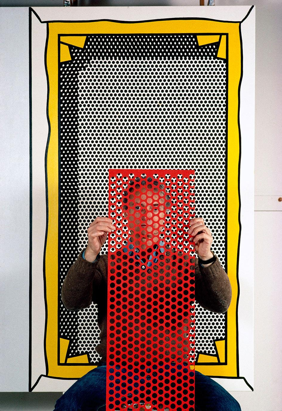 Thomas Hoepker,Roy Lichtenstein, pop artist, with painting and dot template at his studio. Southampton, New York, USA. 1982