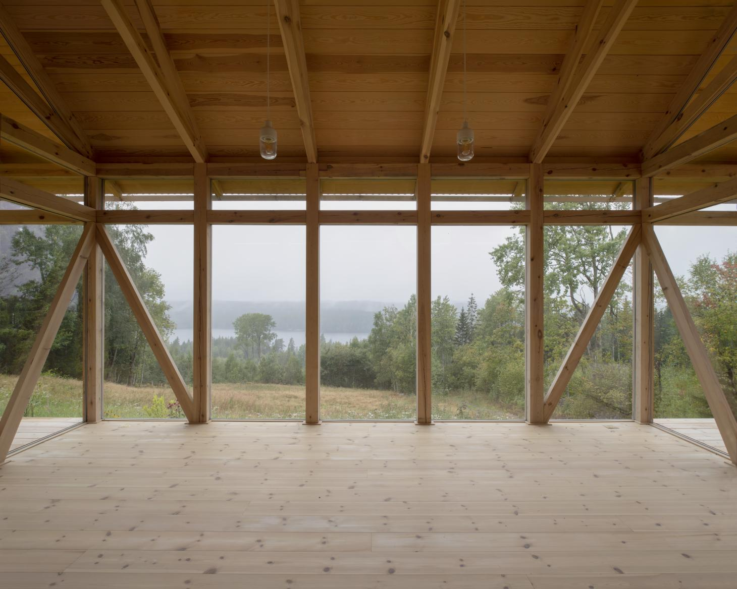 inside looking out at Swedish countryside cabin