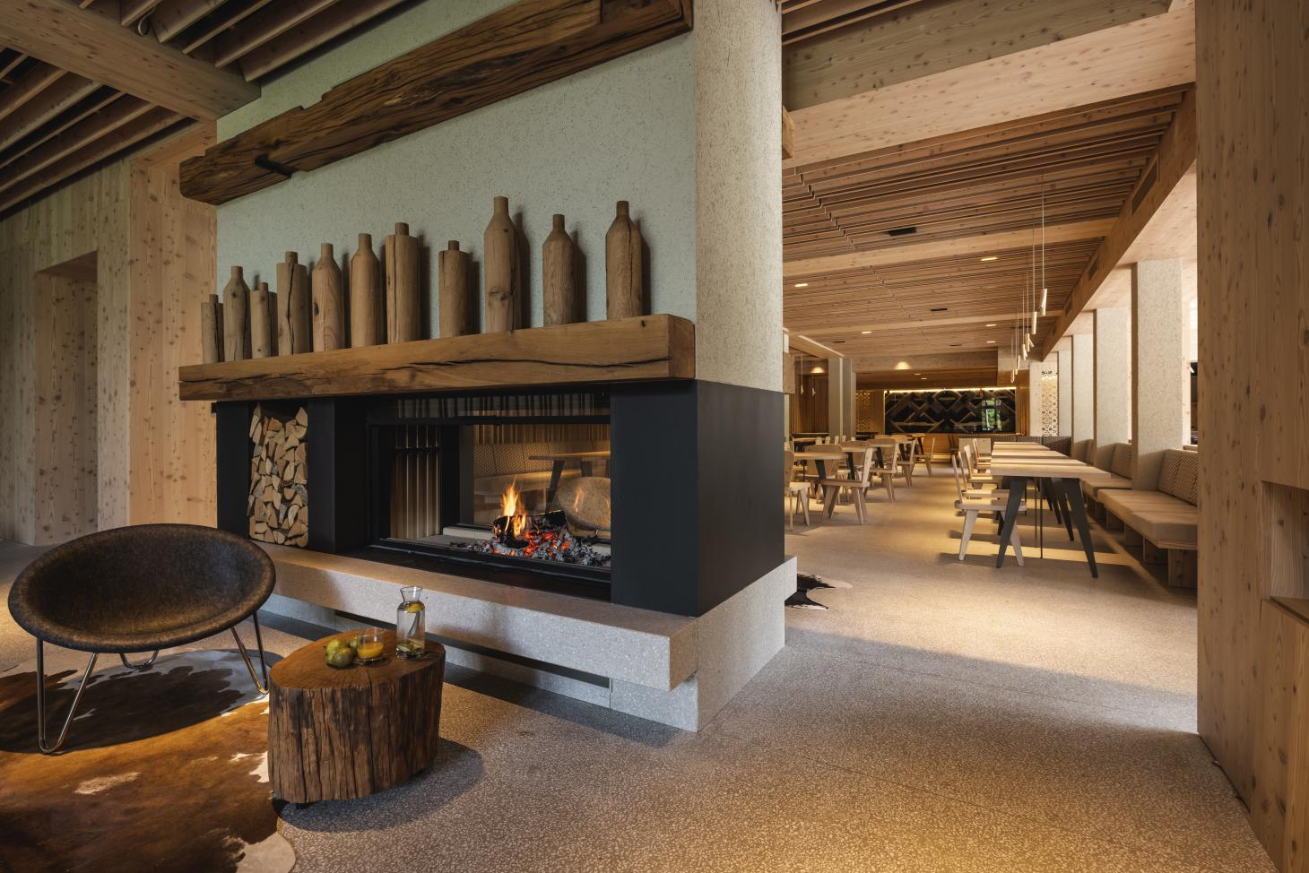 cosy interiors and lots of timber create a warm atmosphere in this hotel in Slovenia