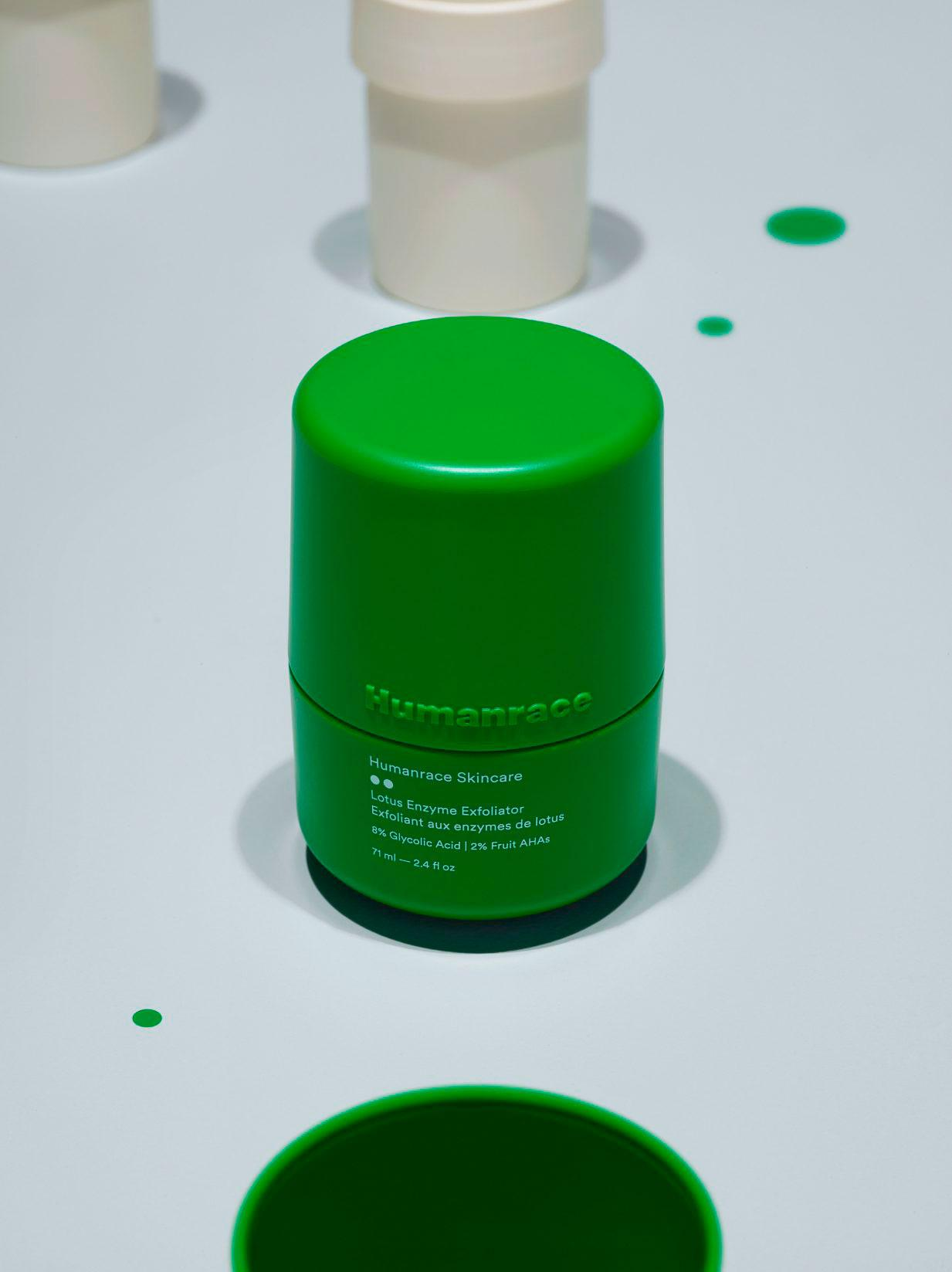 Pharrell Williams Humanrace Lotus exfoliator in bright green packaging against white background