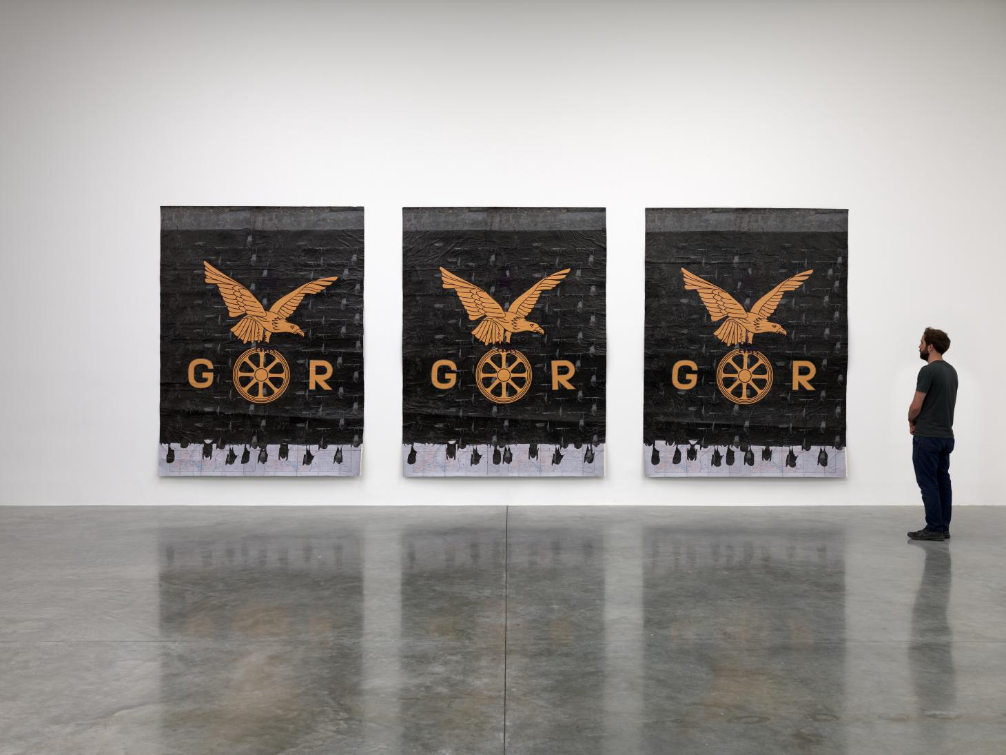 Black and orange artwork by Ibrahim Mahama, featuring bats, at White Cube gallery