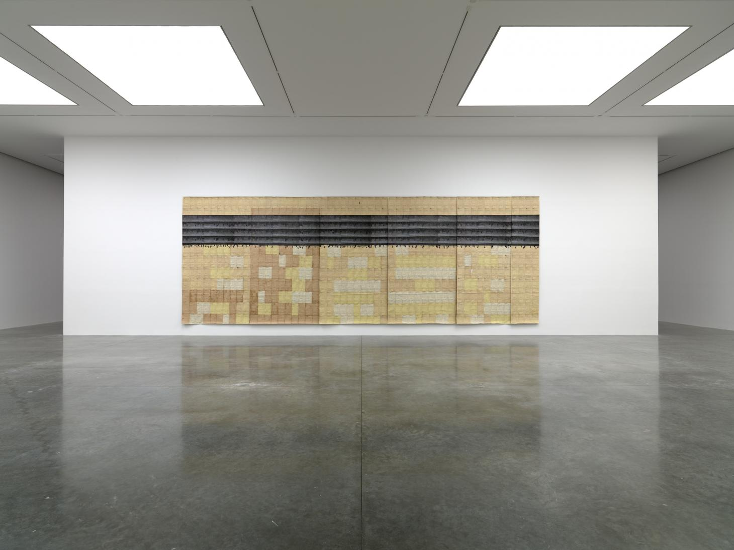 Large-scale artwork on white wall with black floor at White Cube