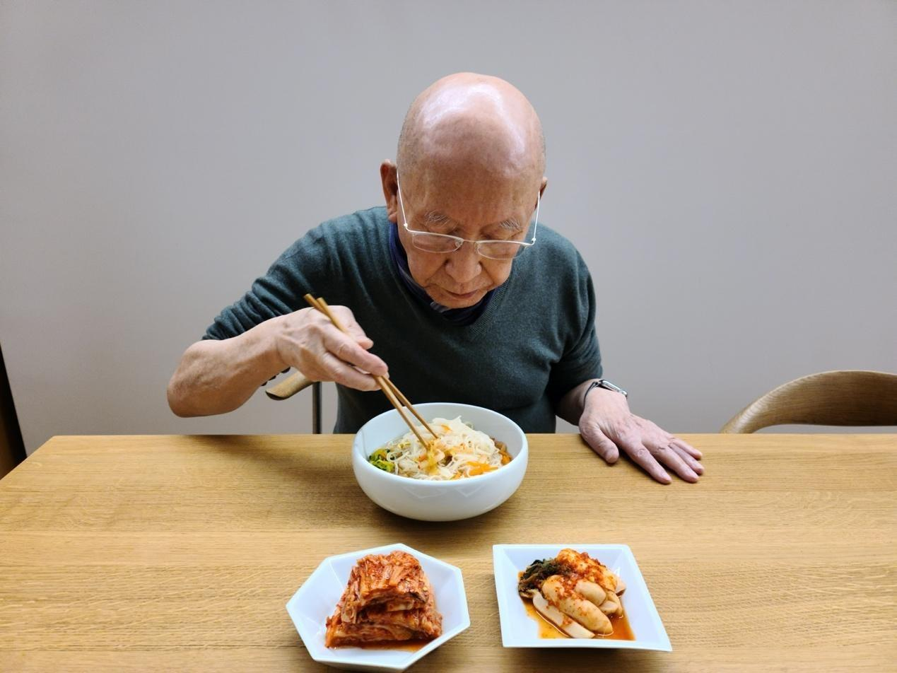 Portrait of artist Park Seo-Bo with his janchi guksu, a recipe for Wallpaper's May 2021 Artist's Palate feature