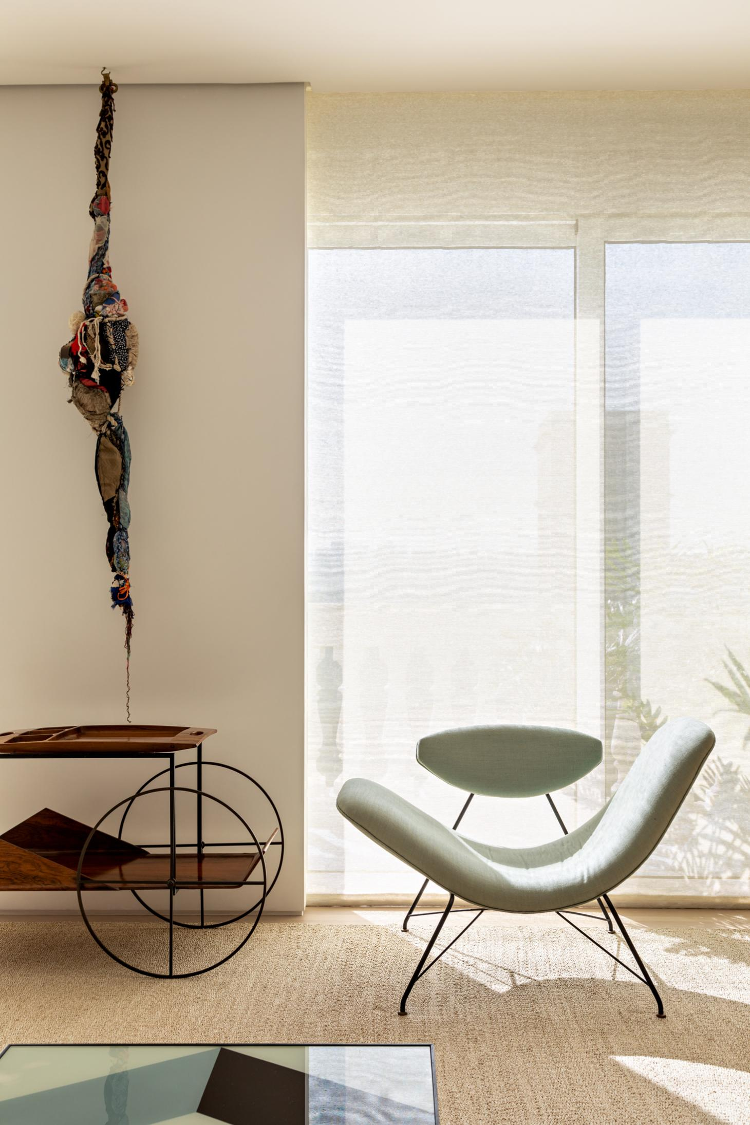 interior detail with art at apartment all by Arthur casas in Brazil