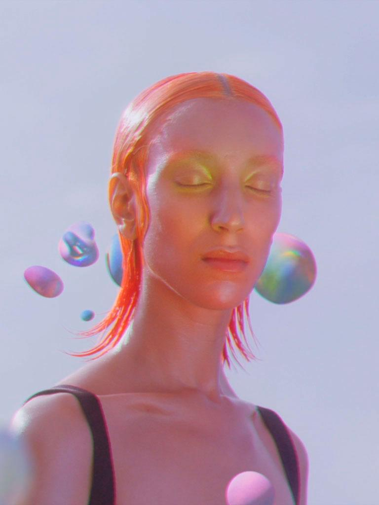 ines alpha instagram filter collaboration with Bimba y Lola showing pink tinted girl standing among pastel blobs