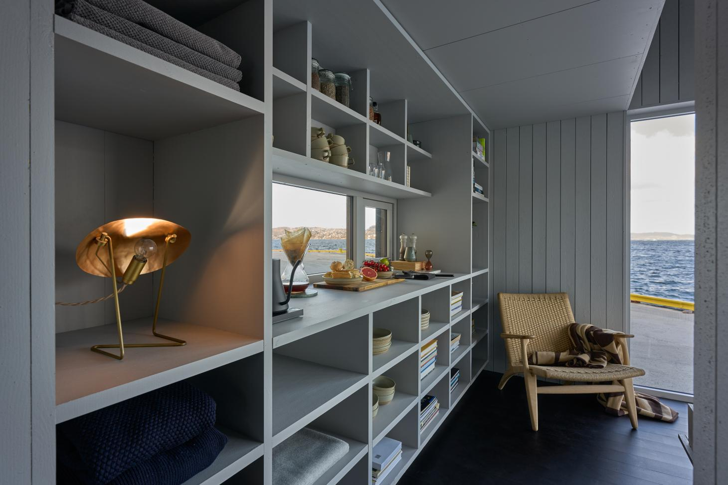 The XS Minihus by Saunders Architecture includes built-in storage and can be supplied with a full kitchen