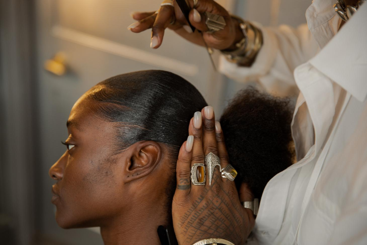 Hairstylist Issac Polen working on a clients hair during his Browns London residency