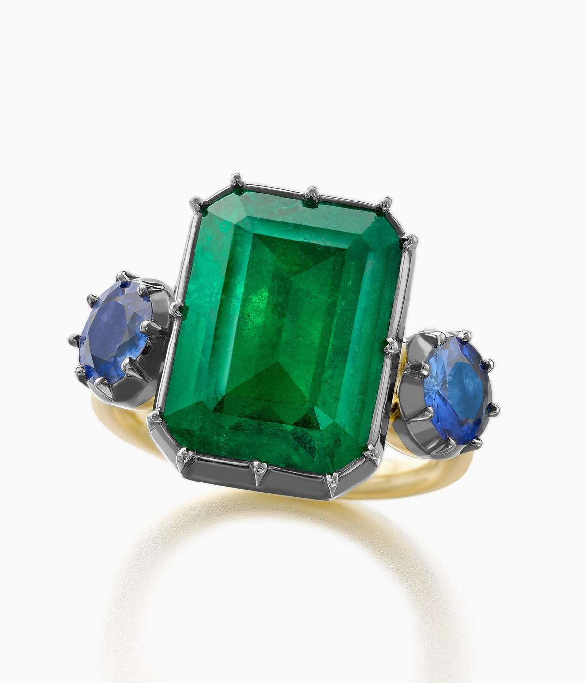 engagement ring with green and blue stone