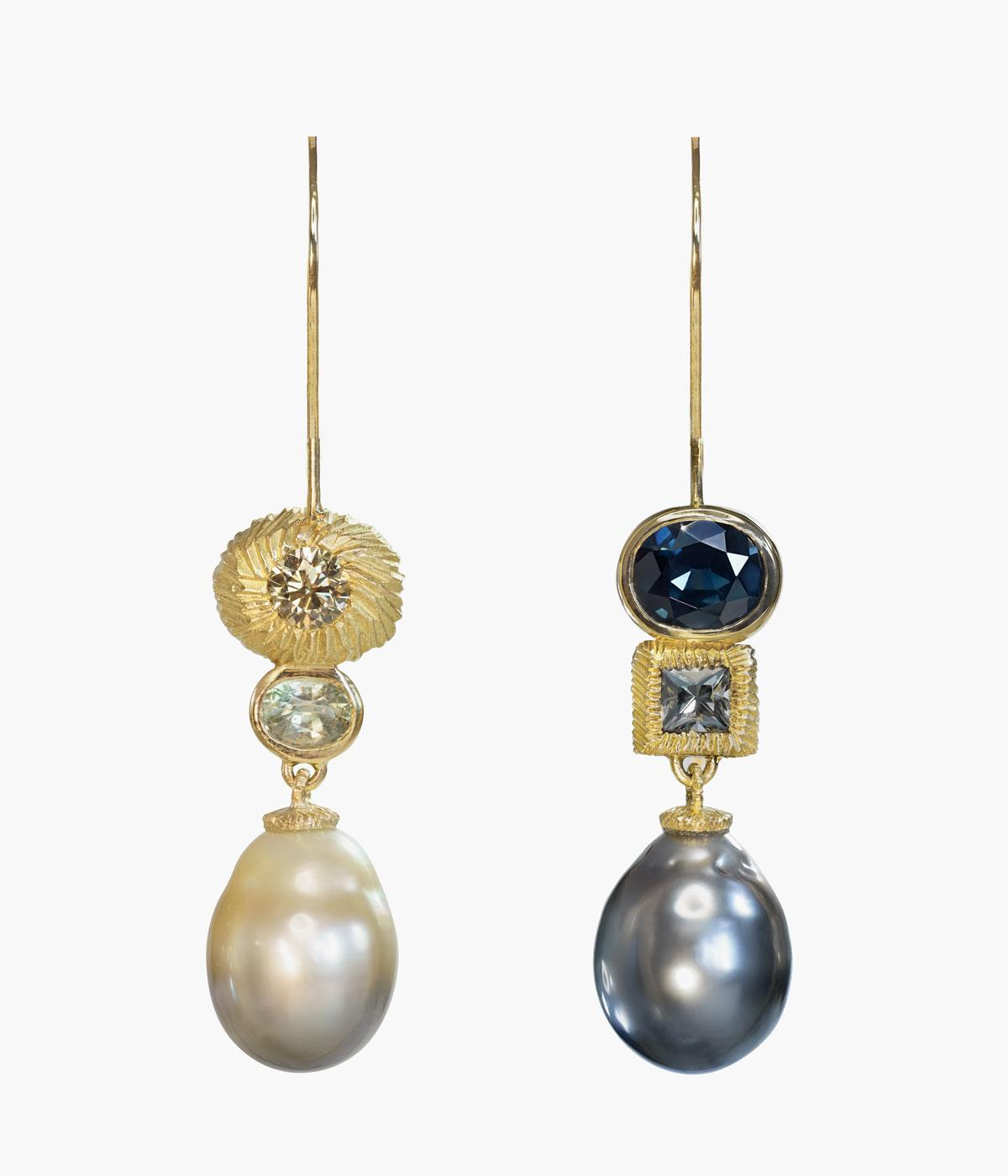 Grey and white pearl earrings with precious stones