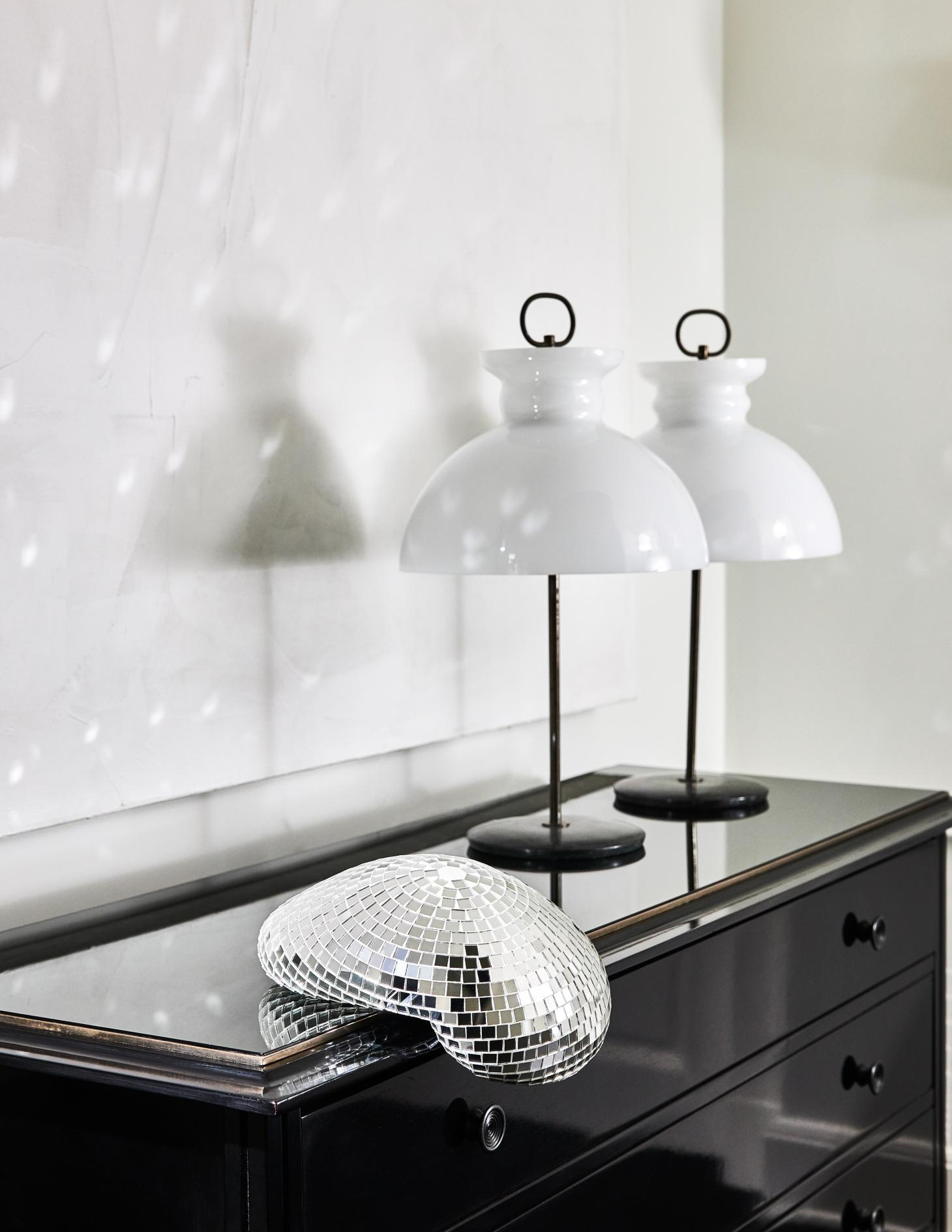 Small melted disco ball by Rotganzen on the edge of a console table