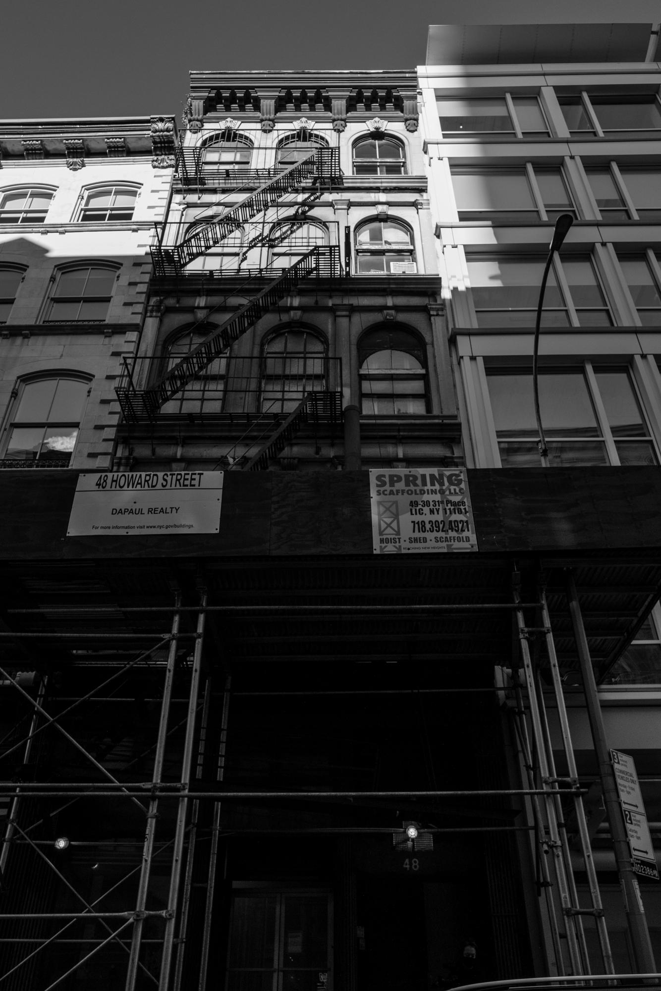 Black and white image of the exterior of Christo's studio, outside 48 Howard Street, NYC