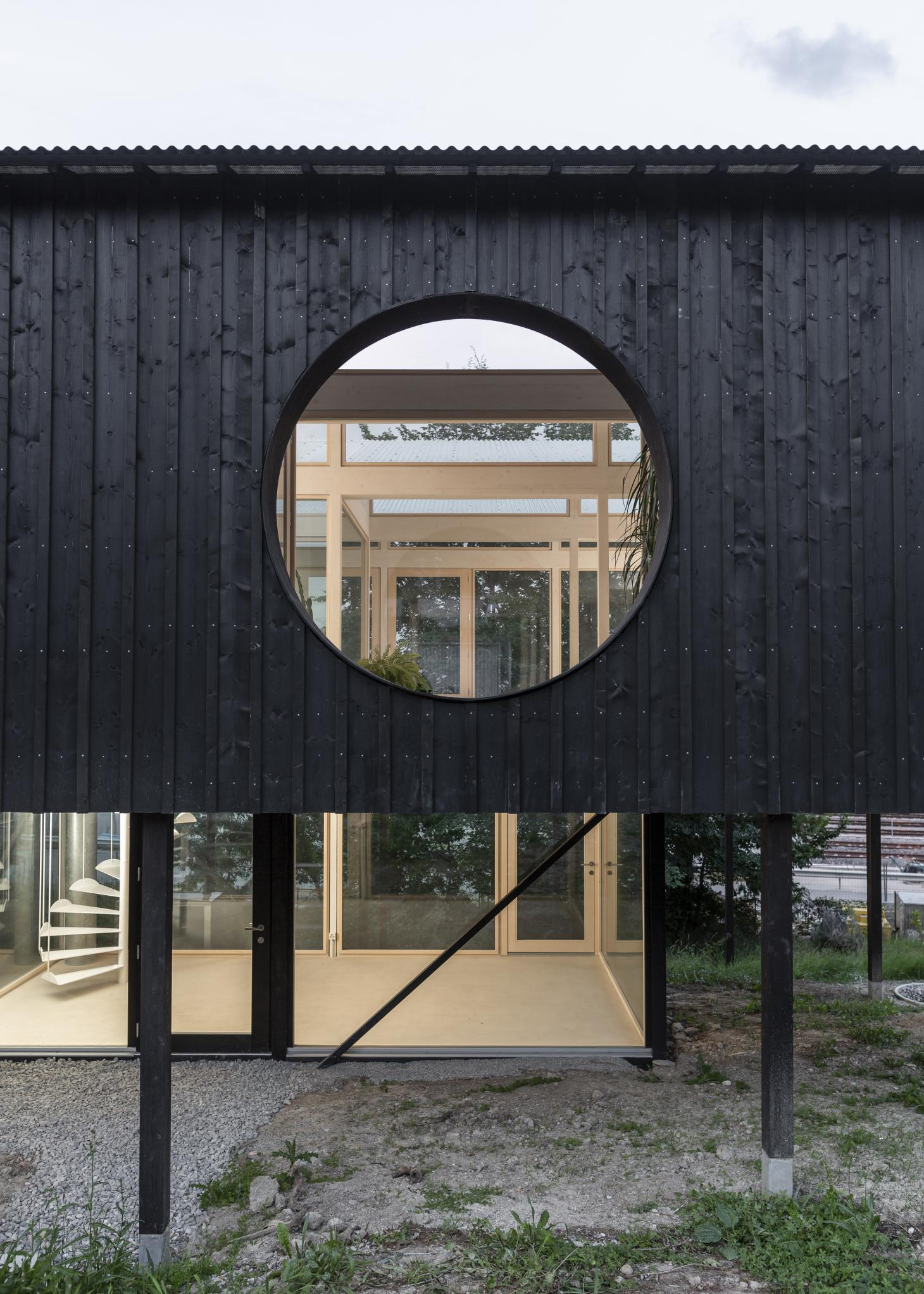 Timber facade with circular opening