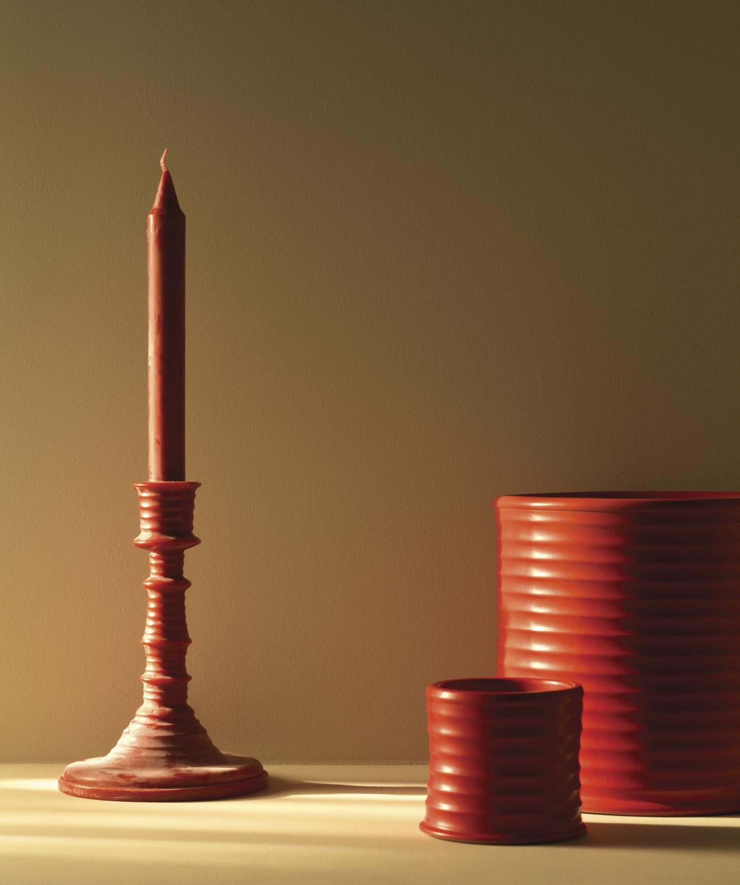 tomato scented red candle and red candelabra by Loewe