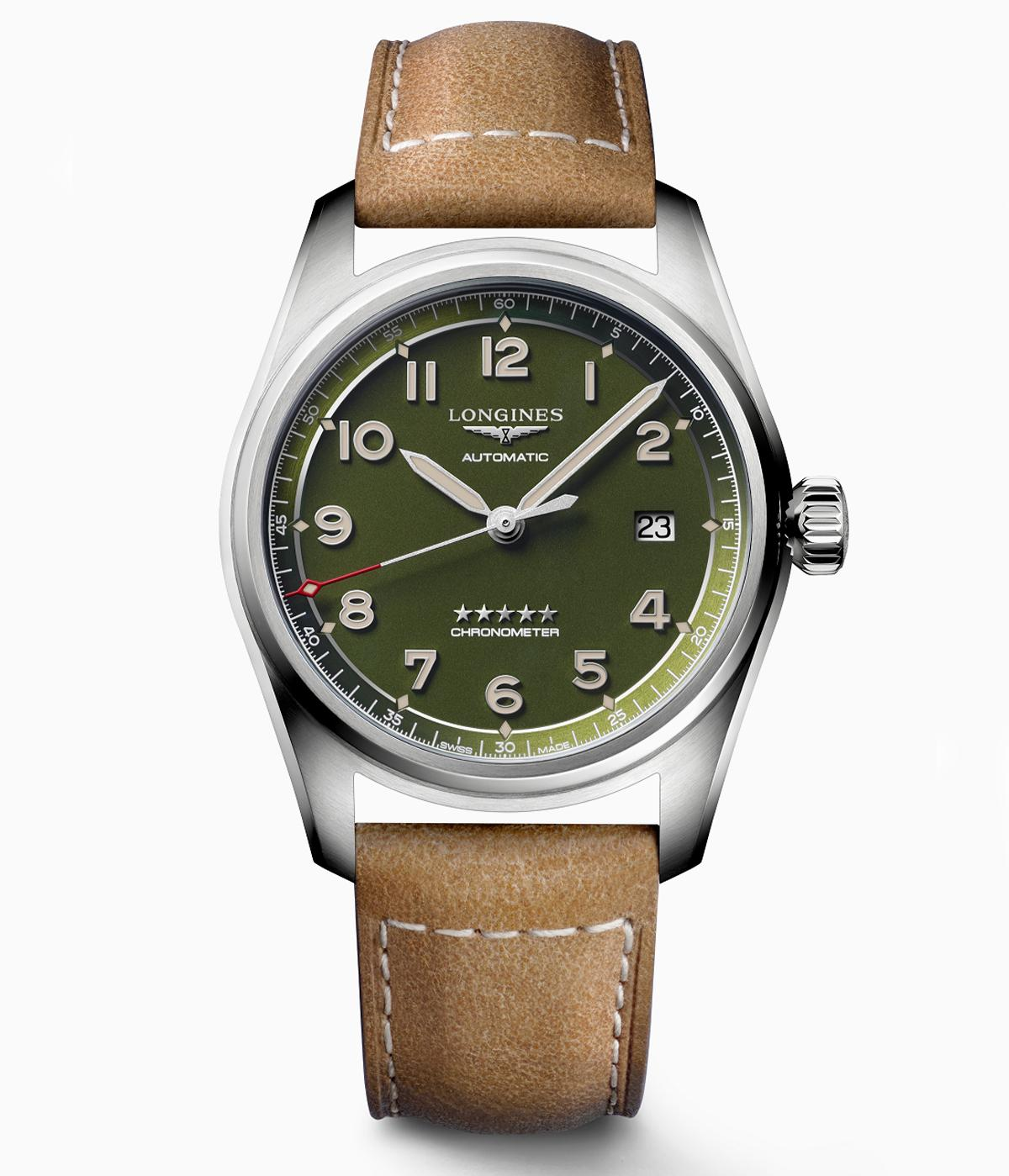 Longines watch with green face and brown leather strap