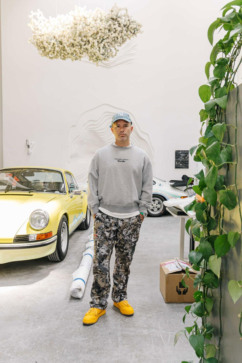 Portrait of Daniel Arsham in his studio featuring car sculptures for a new show at Library streett collective, Detroit