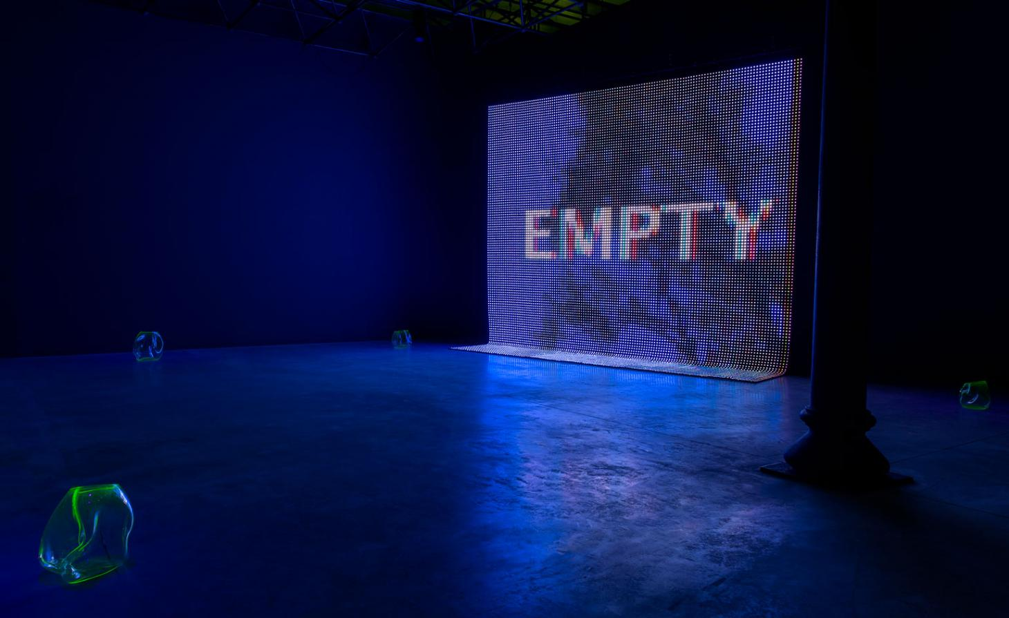 A blue screen saying Empty in an empty exhibition space
