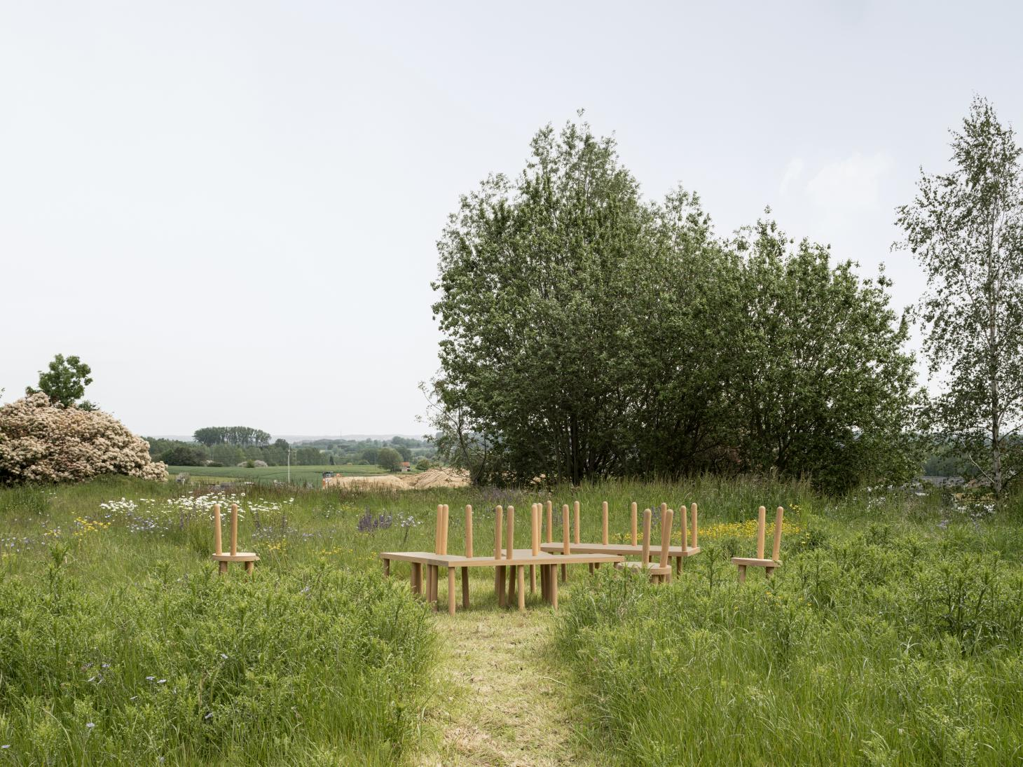 Wooden furniture inspired by Shaker photographed in a garden in the Belgian countryside