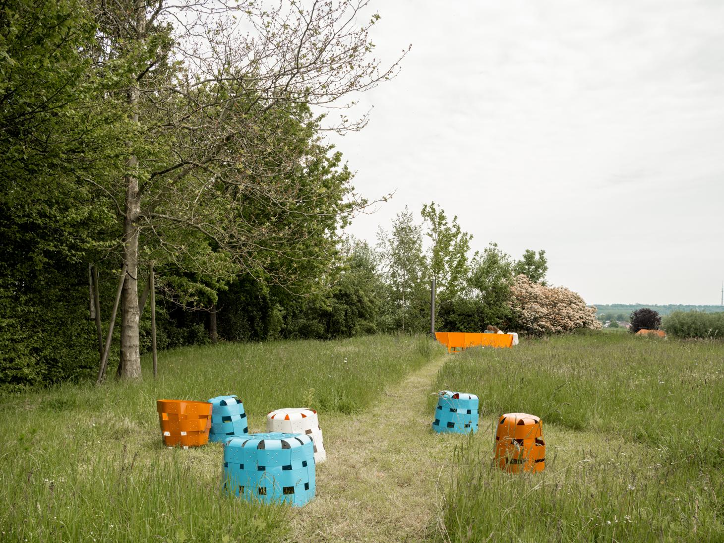 Orange and turquoise baskets shown in a garden