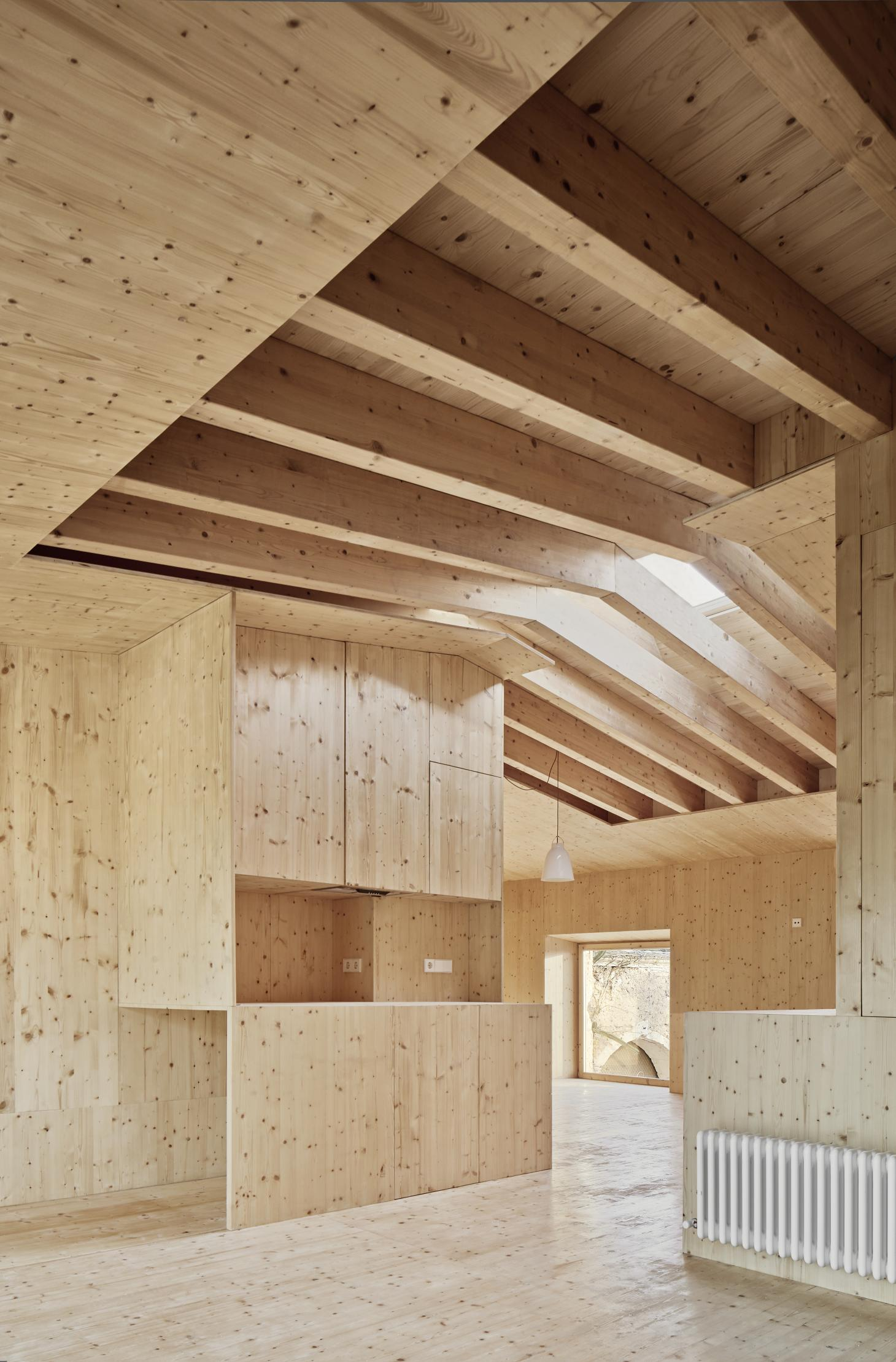 dramatic architectural wood and soaring ceilings feature in this residential project in Spain