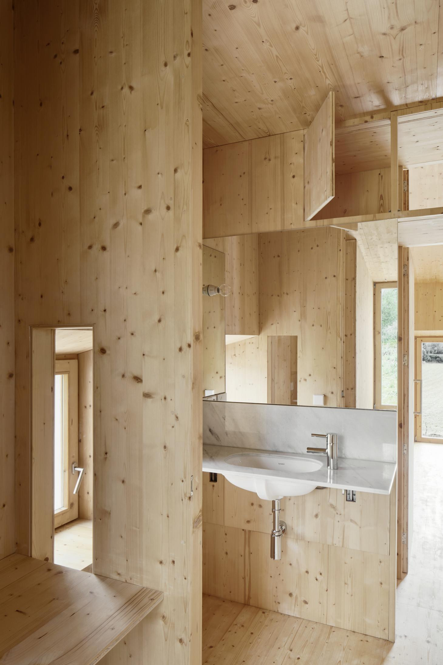 even the bathroom is made out wood in House in a House by MAIO