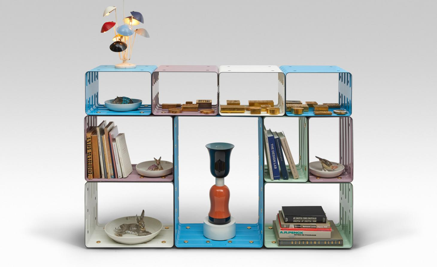 Brightly coloured shelving unit with a lamp on top