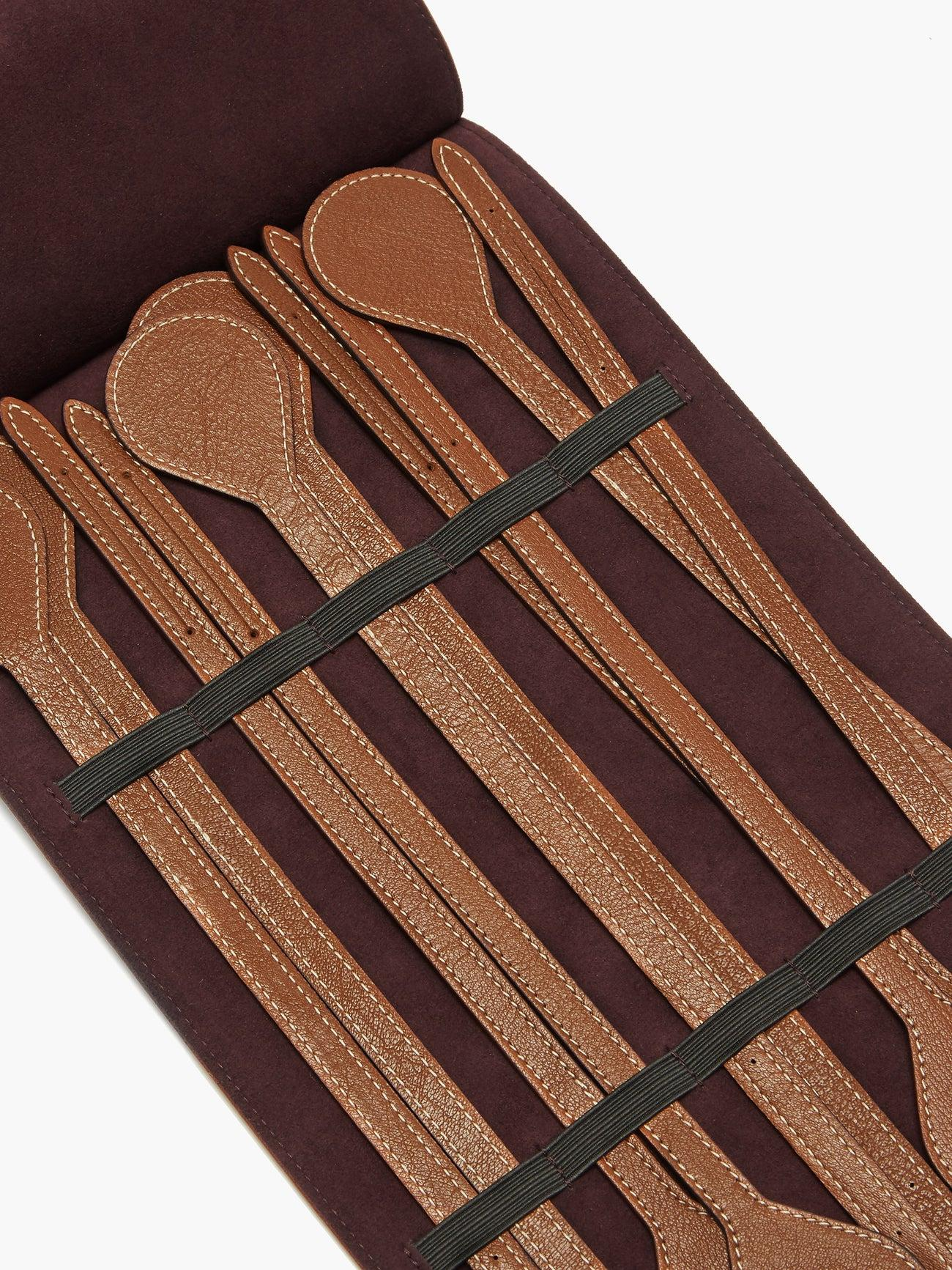 Leather napkin ties in a case