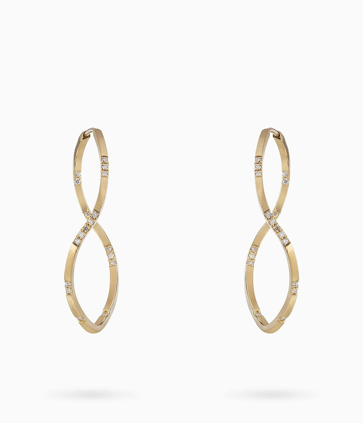Gold and diamond hoops which twist over