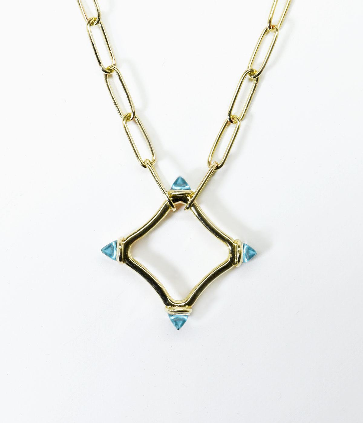 Gold chain necklace with a blue-tipped gold star hanging down