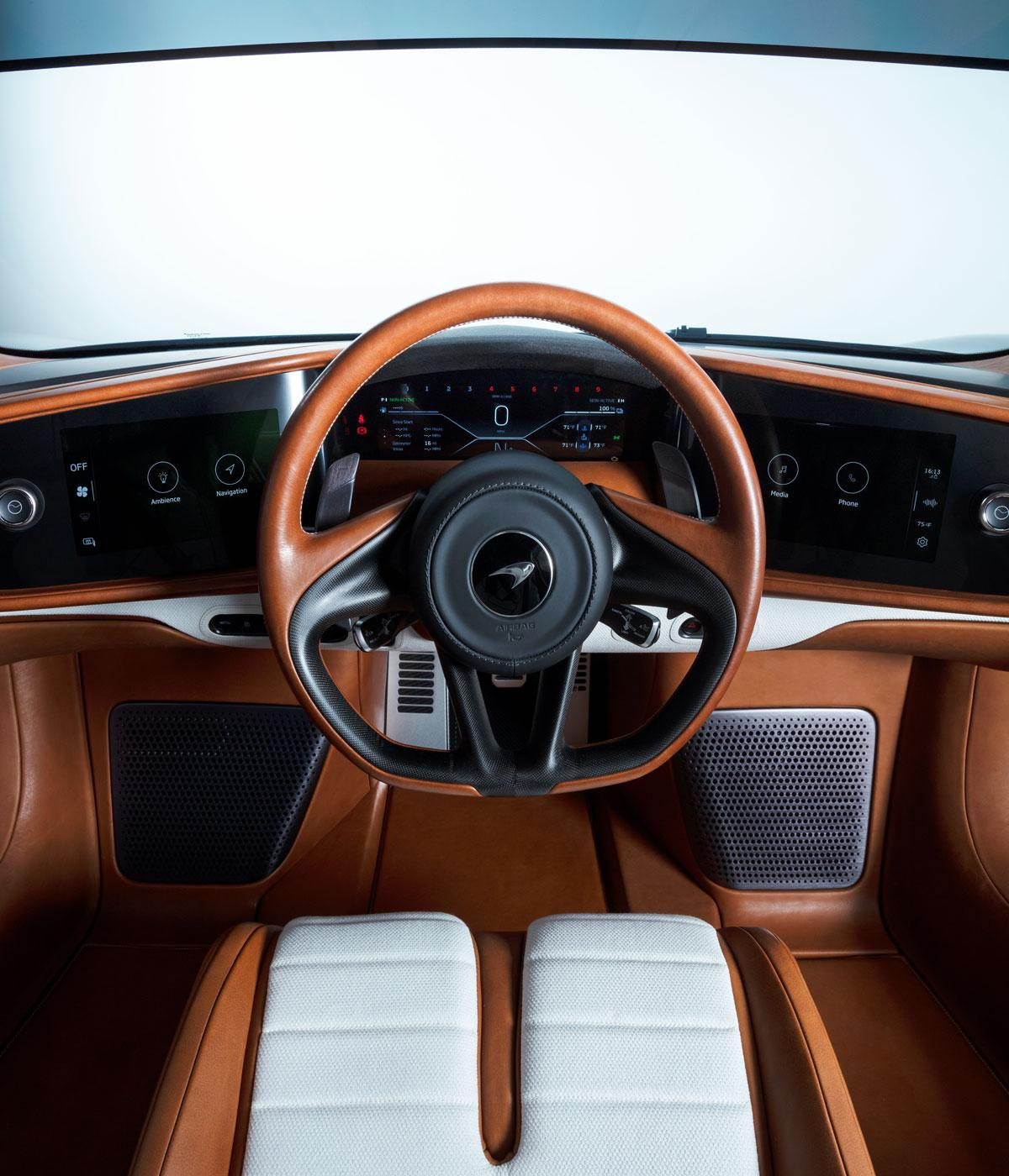 A steering wheel in brown leather in a sports car