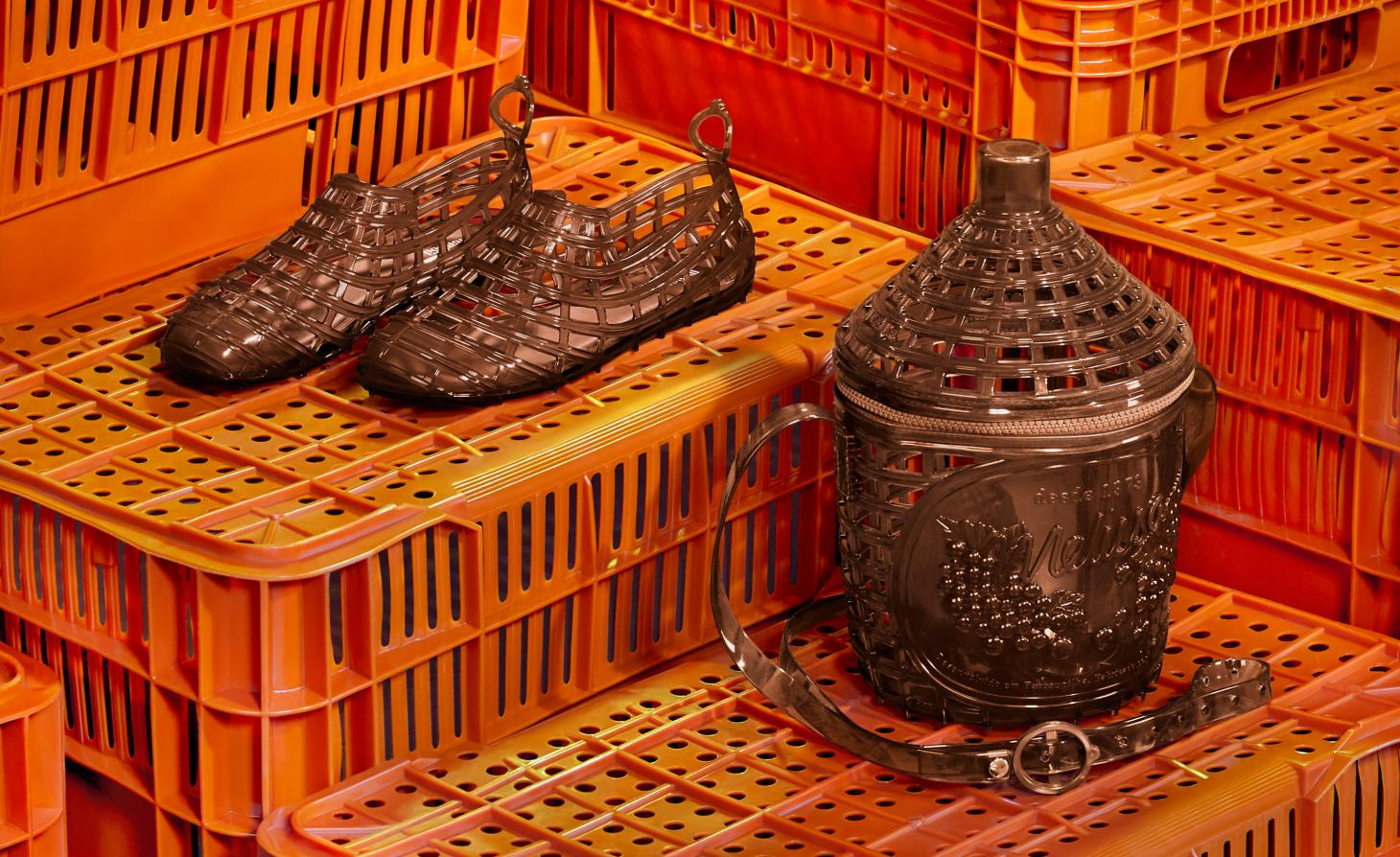 A pair of brown lattice shoes lie on orange plastic crates