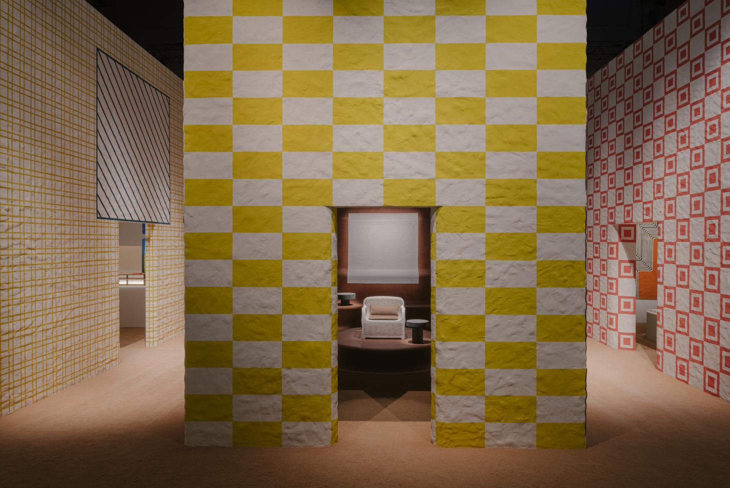 Hermes home collections at salone del mobile in Milan shown inside lime plaster structures with striped surfaces