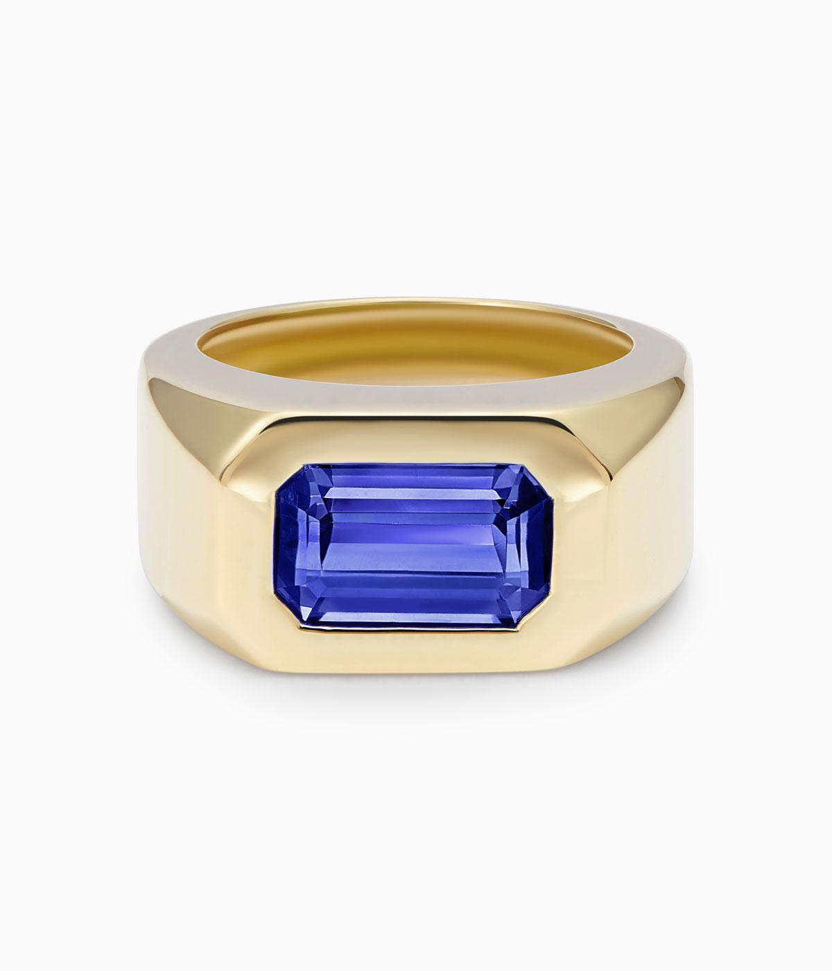 Gold ring with blue stone in middle