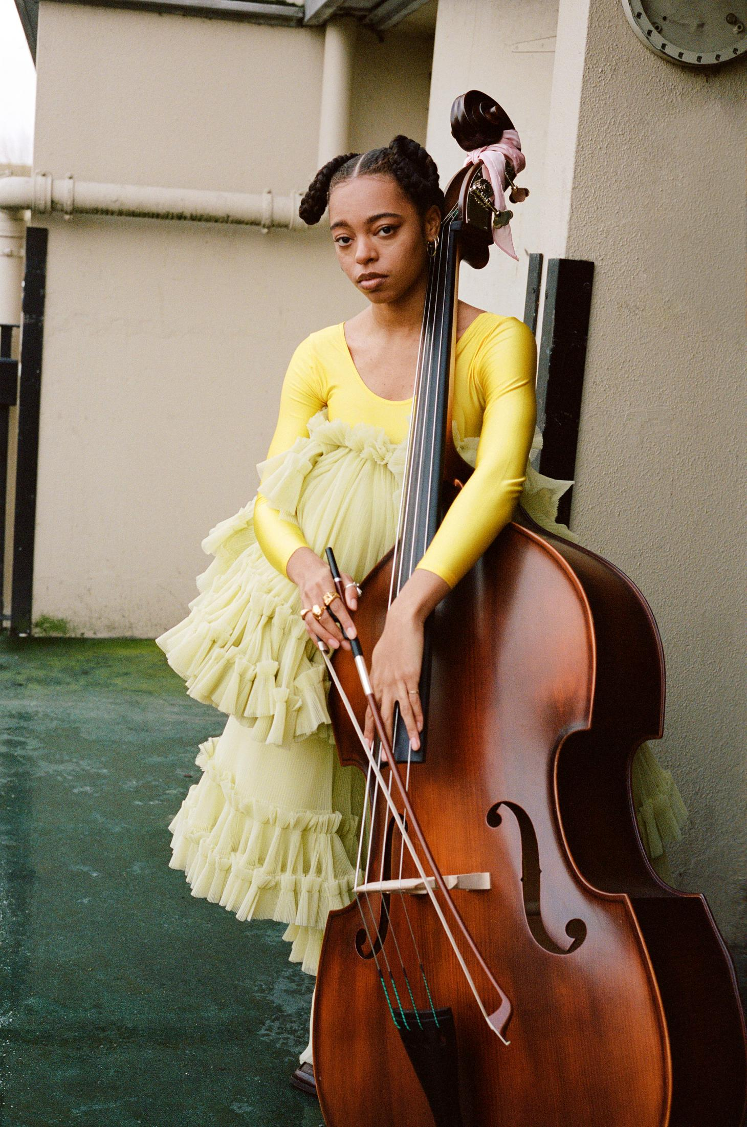 Still from Fenn O'Malley film of girl with cello in yellow dress
