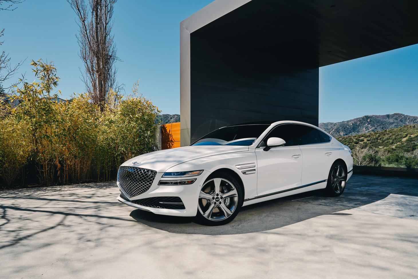 Genesis G80 exterior view with architeture in the background