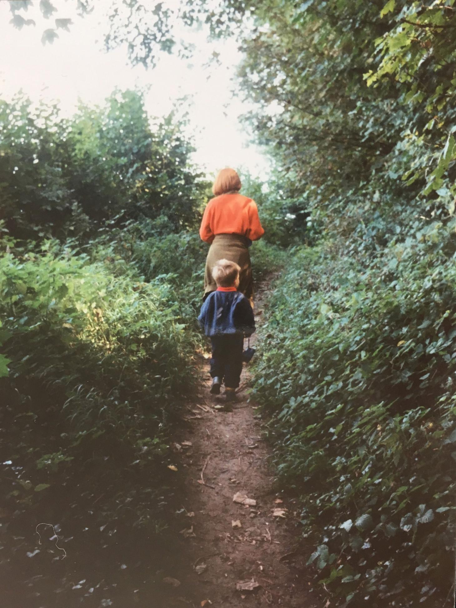 Guy Morgan walking through the woods with his botanist mother