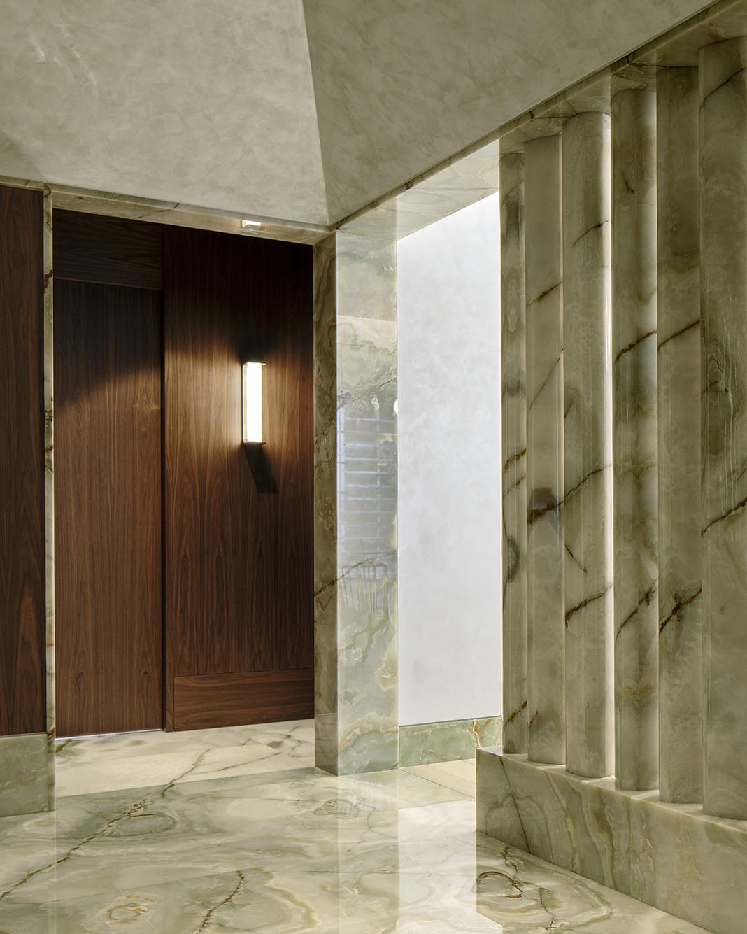 marble interiors with colonnade at Brewin apartment by Robert Cheng